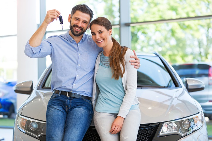 Couple Purchasing New Car